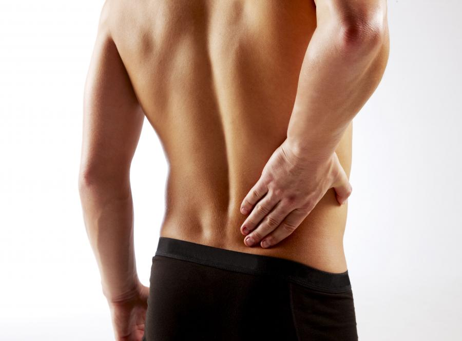 Фото Young man with back pain.