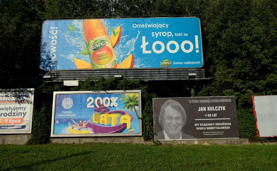 Reklama z wizerunkiem Jana Kulczyka